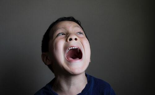 image shows a white child of about five years old screaming