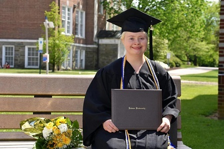 AnnaRose Rubright in her cap and gown, holding her diploma at Rowan University. Photo courtesy of Frank Ieradi