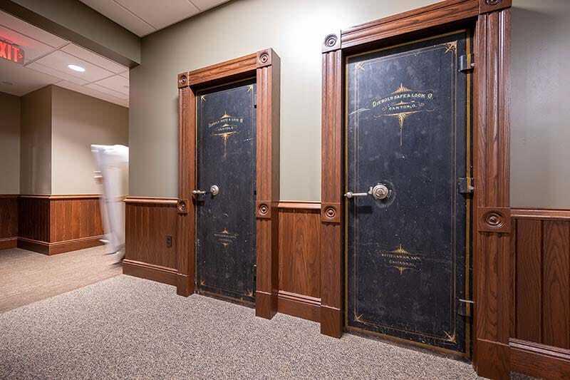 Two black safe doors with gold enscription.