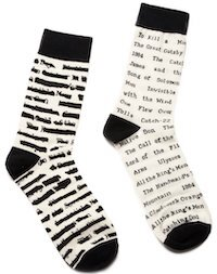 On the right, a white socks lists classic novels that have been banned; the sock on the left features black lines over the titles.